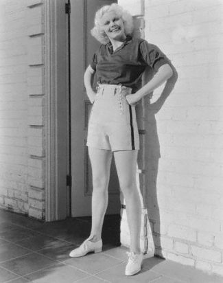 Original caption: White linen shorts with a blue stripe at the sides and a blue shirt of jersey is the choice of Jean Harlow, Metro-Goldwyn-Mayer star. The shorts lace at each side with silk laces. --- Image by © Bettmann/CORBIS