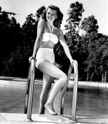Rita-Hayworth-at-home-poolside-in-a-white-bikini-1946-Fun-in-the-Sun-4