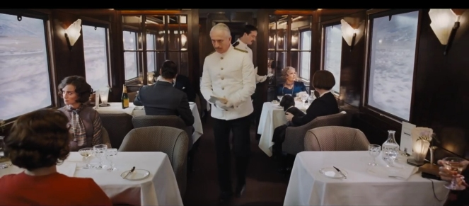 Murder On the Orient Express 2017 conductor in dining car.jpg